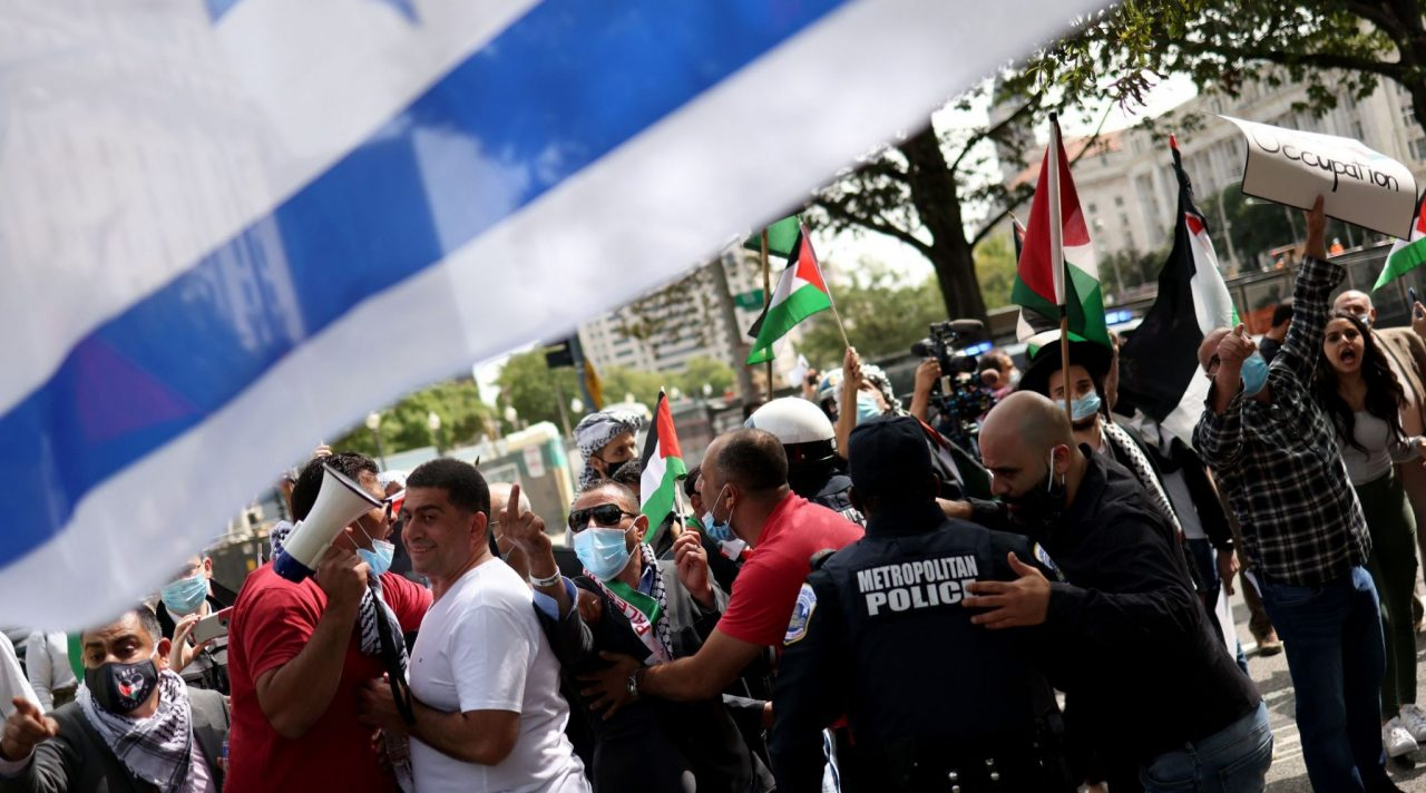 Protesters from Palestinian rights organizations scuffle with a pro-Israel group outside the White House, Sept. 15, 2020. (Photo/JTA-Win McNamee-Getty Images)