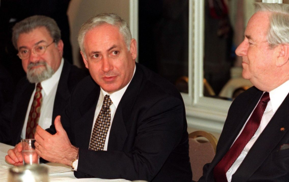 Israeli Prime Minister Benjamin Netanyahu (center) speaks to the Christian conservative group Voices United for Israel in Washington, Jan. 19, 1998. He is flanked by the late Eliyahu Ben Elissar (left) then Israel's ambassador to the U.S., and the late Rev. Jerry Falwell. (Photo/JTA-William Philpott-AFP via Getty Images)