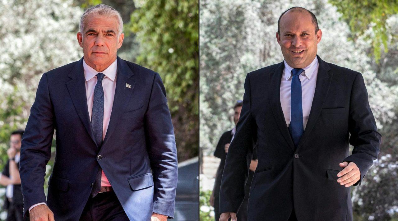 Yair Lapid, left, and Naftali Bennett arrive at Israeli parliament in Jerusalem, May 5, 2021. (Photo/JTA-Oren Ben Hakoon-AFP via Getty Images)