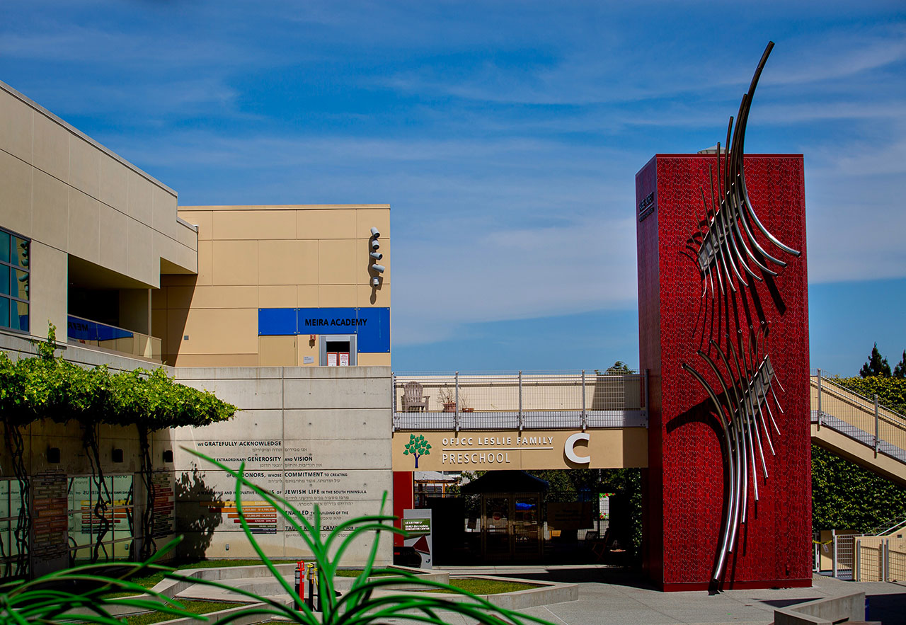 """""""Chai,"""" a new musical sculpture by Richard Deutsch, towers over the courtyard at the Oshman Family JCC in Palo Alto."""