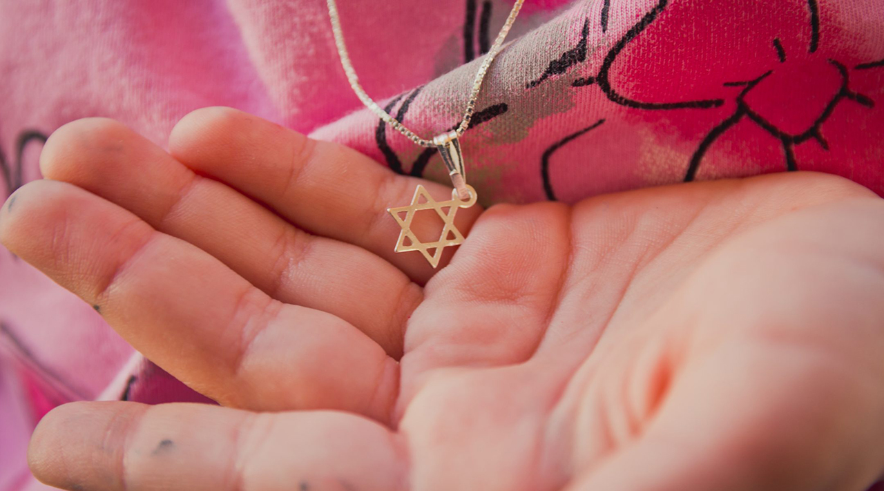 Star of David necklaces are a signifier of Jewish identity and, some fear, a potential risk during times of antisemitism. (Photo/JTA-Getty)