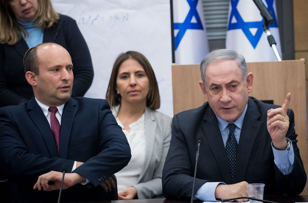 Naftali Bennett, left, then Israeli defense minister, looks on at then-Prime Minister Benjamin Netanyahu during a meeting of right-wing parties, March 4, 2020. (Photo/JTA-Yonatan Sindel-Flash90)