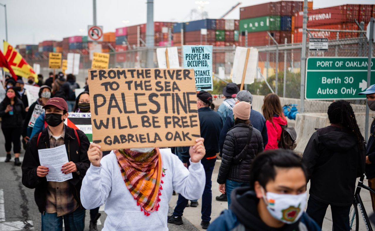 """Protesters at the Port of Oakland on June 4, 2021. """"From the river to the sea"""" is generally understood as a call for the dissolution of the state of Israel.  (Photo/Brooke Anderson)"""