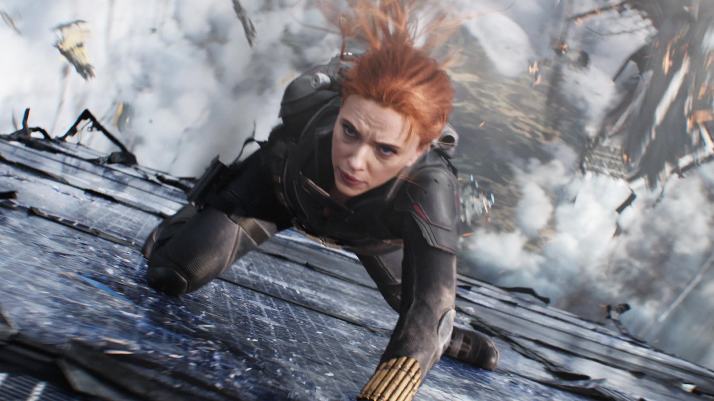"Scarlett Johansson performing a superheroic feat of derring-do in ""Black Widow."""