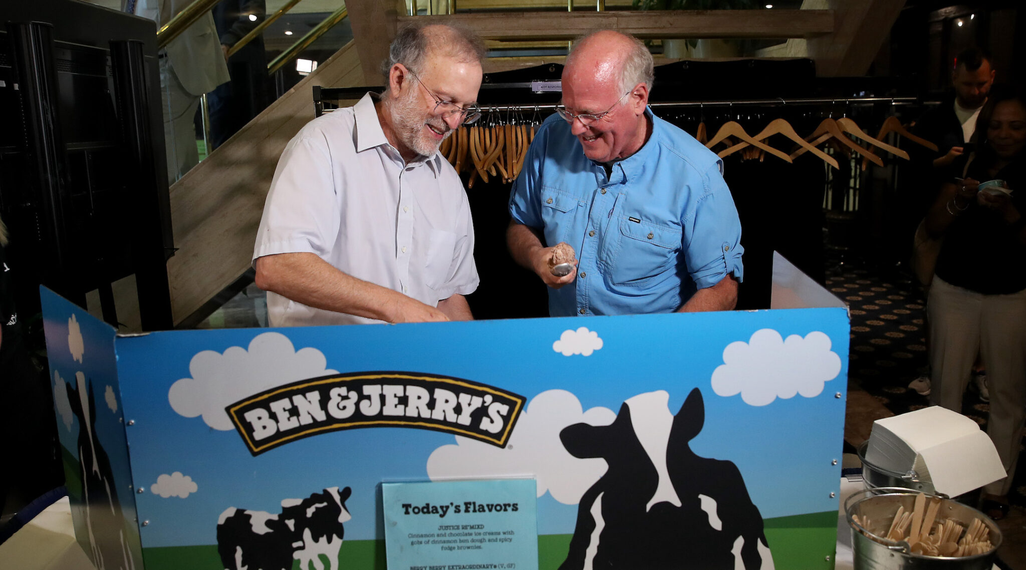 Ben & Jerry's co-founders Jerry Greenfield (left) and Ben Cohen serve ice cream following a press conference announcing a new flavor in Washington, D.C., Sept. 3, 2019. (Photo/JTA-Win McNamee-Getty Images)