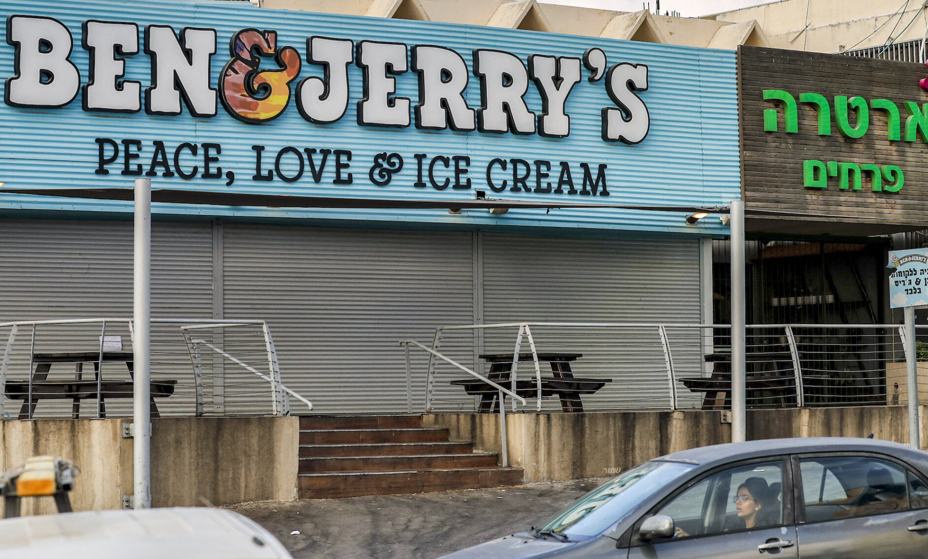 Motorists drive past a closed Ben & Jerry's ice-cream shop in the Israeli city of Yavne, south of Tel Aviv, July 23, 2021. (Photo/JTA-Ahmad Gharabli-AFP via Getty Images)