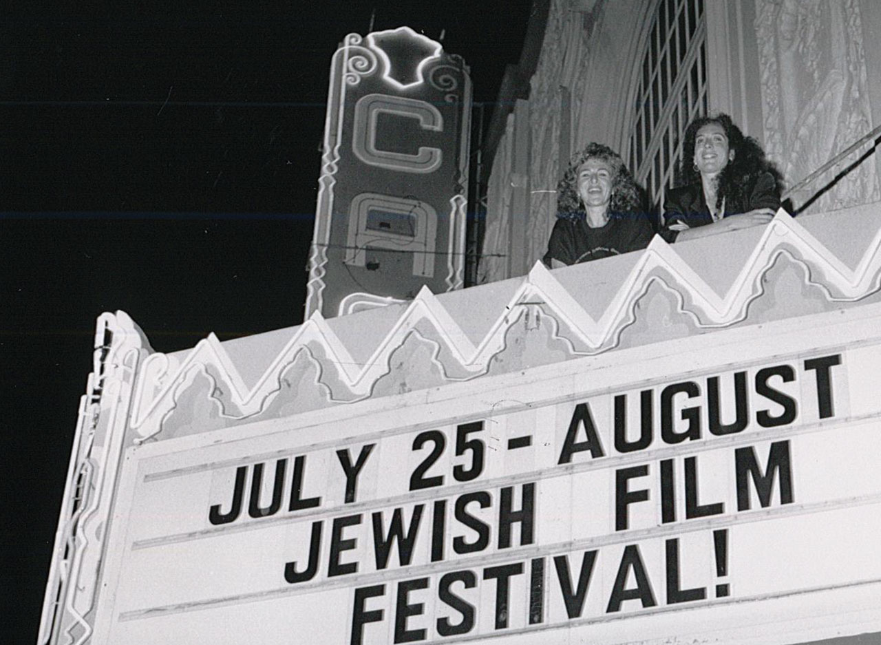 San Francisco Jewish Film Festival co-directors Deborah Kaufman and Janis Plotkin in 1991 on the balcony of the Castro Theatre. (Photo/File)
