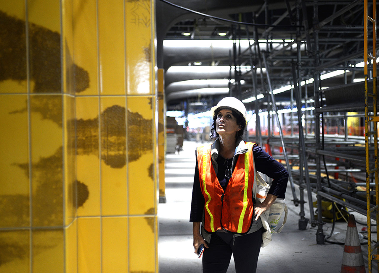 """Amy Trachtenberg on the Milpitas BART platform during the installation of her new work, """"Ecstatic Voyaging."""""""