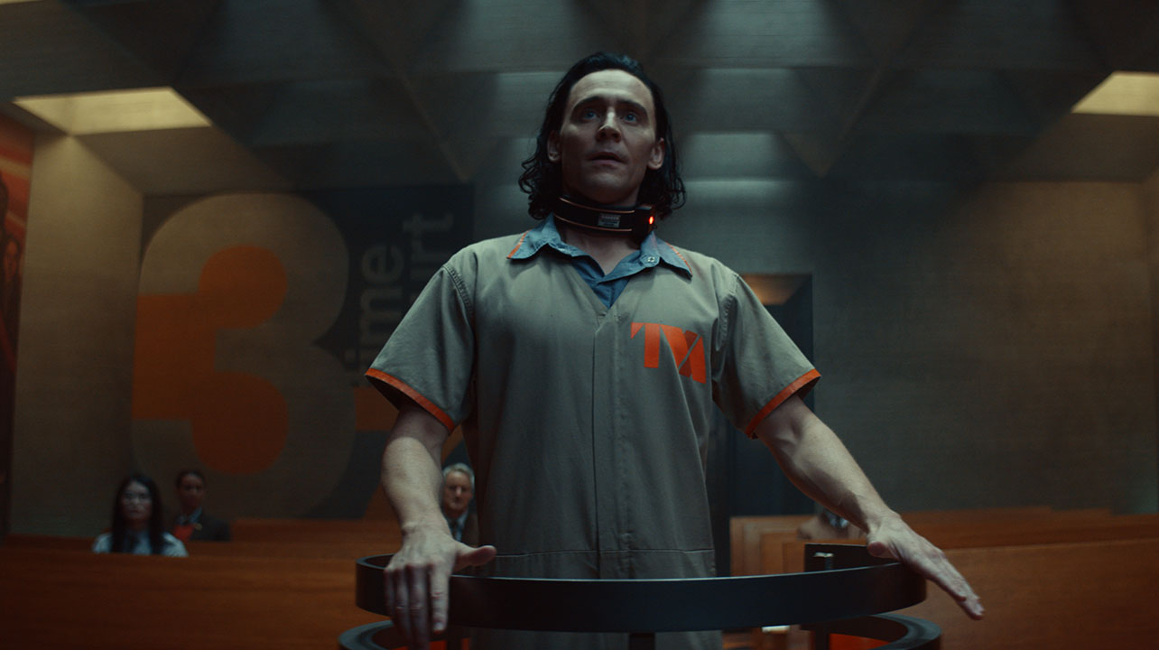 """Loki (Tom Hiddleston) stands before the kisei kevodecha for judgement in the first episode of """"Loki."""""""