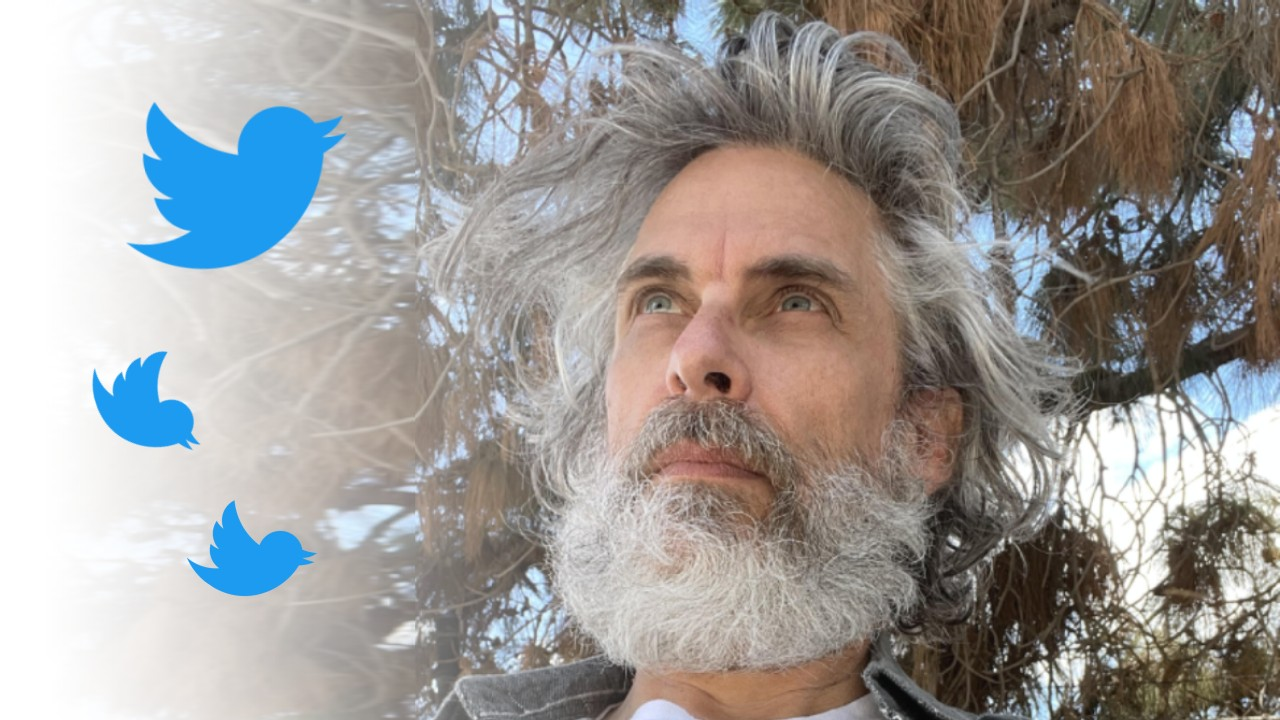Michael Chabon looking at Twitter birds