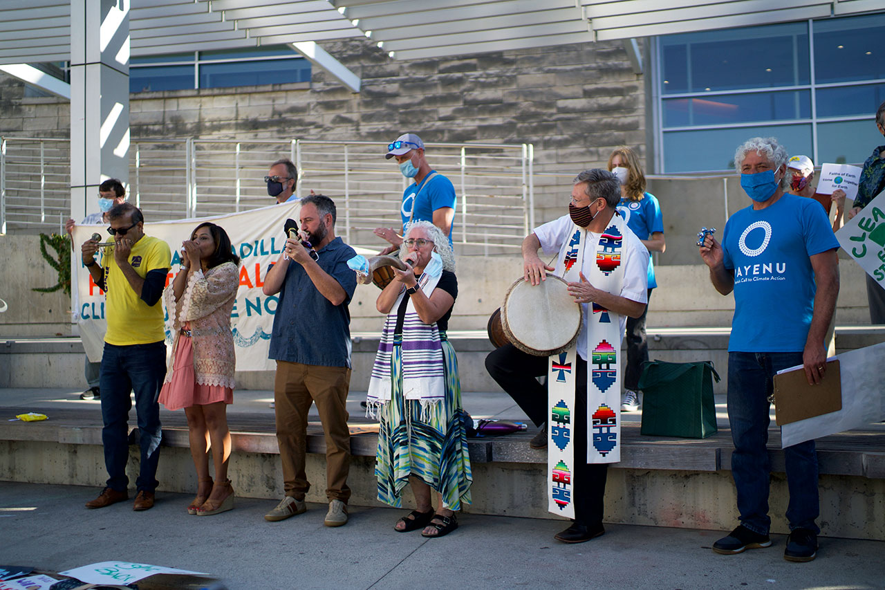 """(From left) Demonstrators use a tutari, a shankh, shofars, a drum and bells to """"Make a Holy Noise for Climate Change"""" on Aug. 25 in San Jose. (Photo/George Barahona)"""