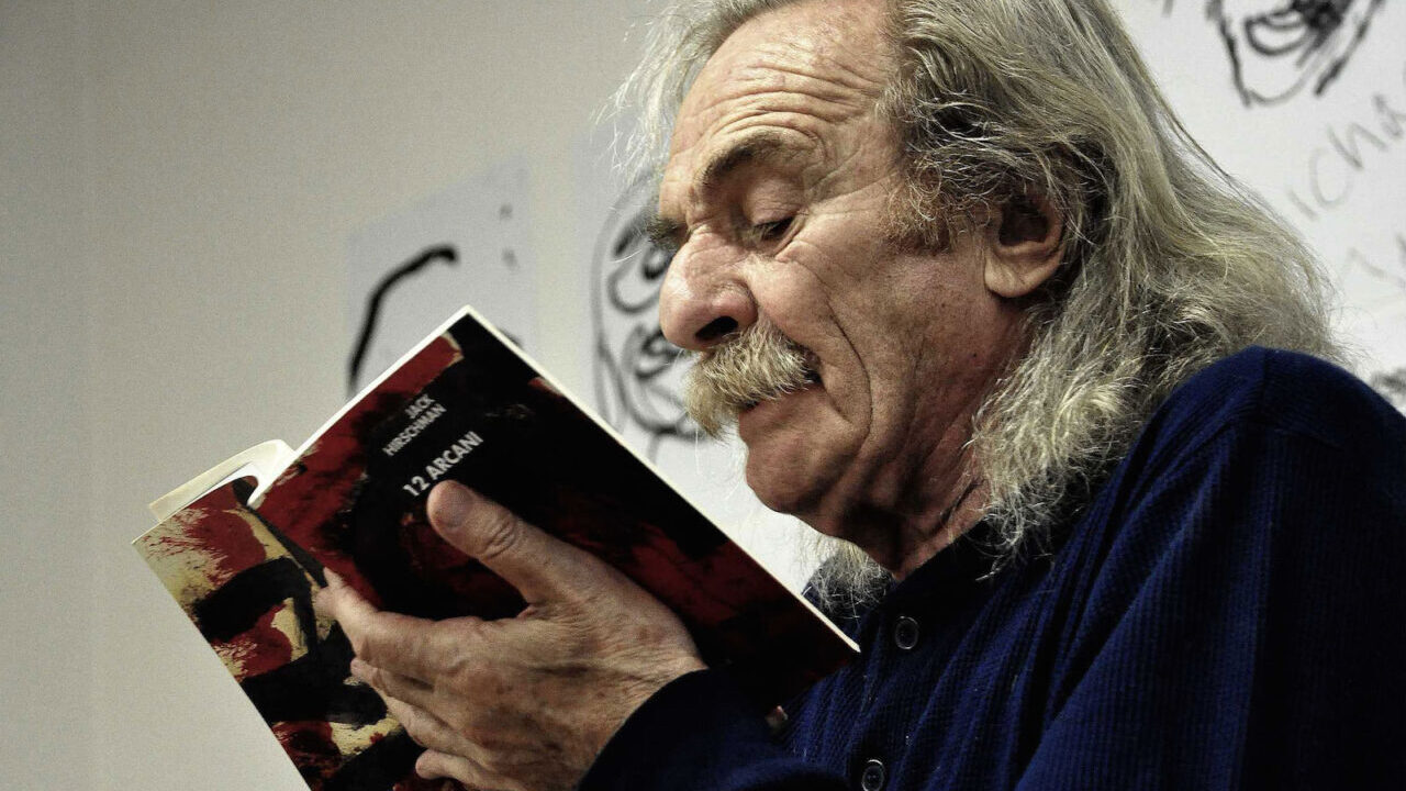 """Jack Hirschman reads from the Italian edition of his book """"The Arcanes."""" (Photo/Marco Cinque)"""