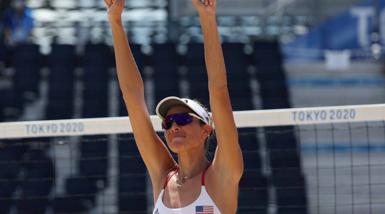 Female athlete raising her arms in victory
