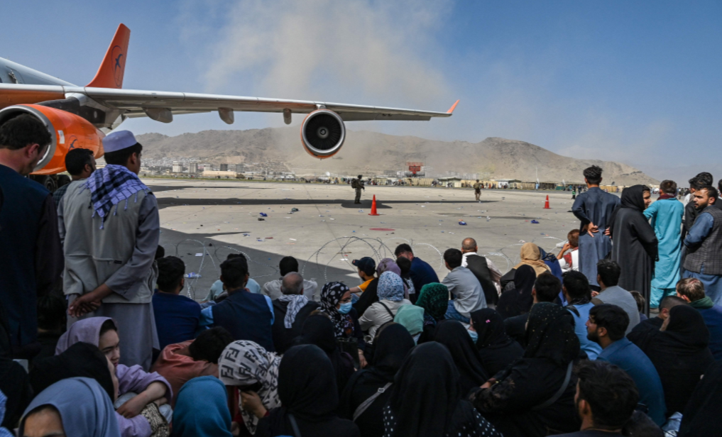 Thousands of Afghans rushed to Kabul's airport trying to flee the country as the Taliban seized power. (Photo/RNS-Wakil Kohsar-AFP via Getty Images)