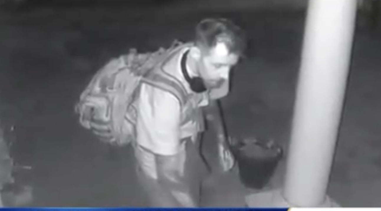 Security footage of a man leaving one of the flyers on a front porch. (Screenshot/KSBW Action News 8)