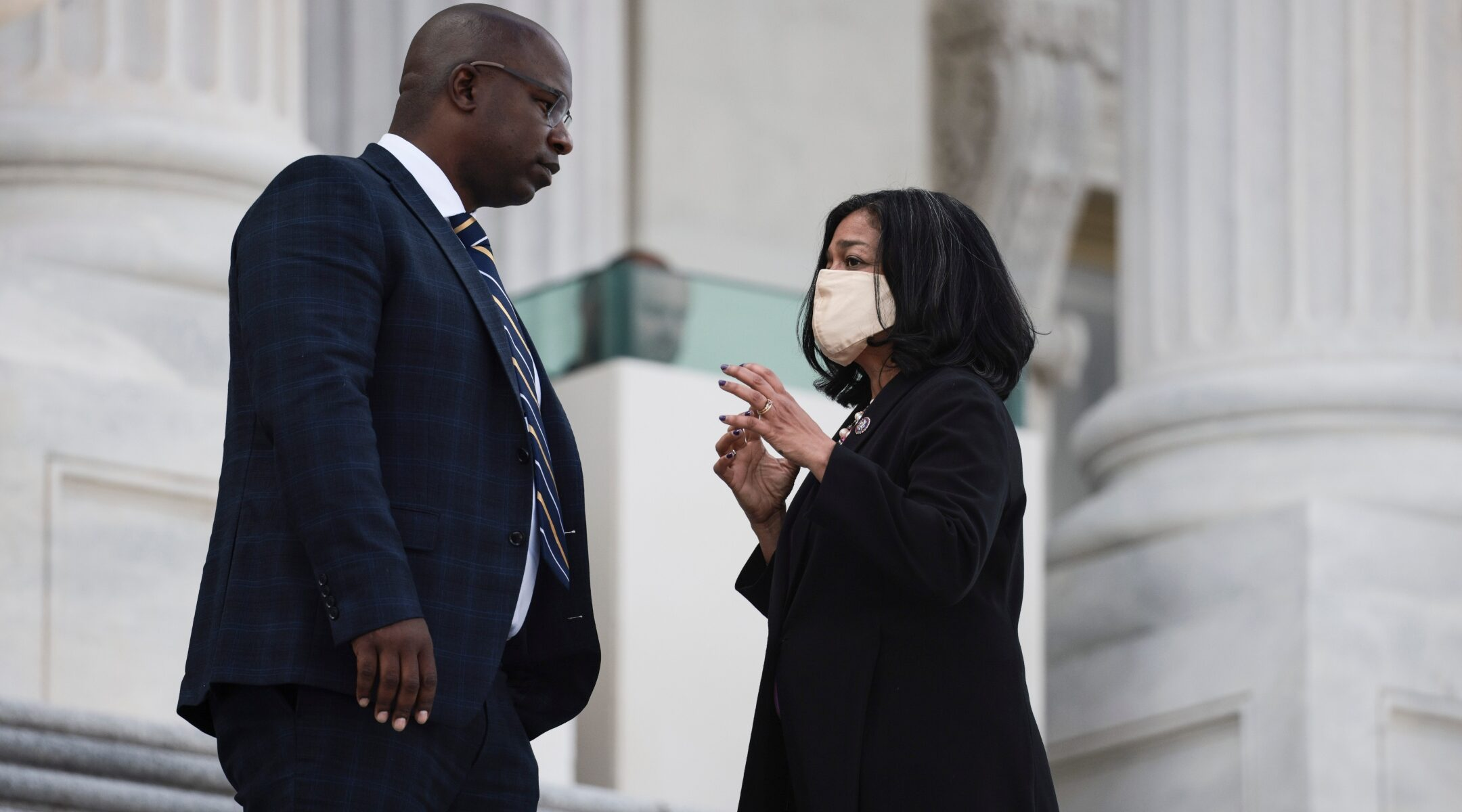 Reps. Jamaal Bowman and Pramila Jayapal speak on the steps to the U.S. Capitol, Sept. 23, 2021. (Photo/JTA-Anna Moneymaker-Getty Images)