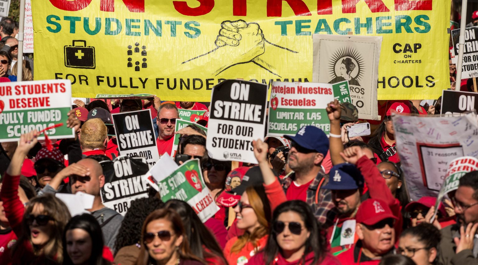 Members and supporters of the United Teachers of Los Angeles union wave and cheer in a downtown Los Angeles park at the end of a strike, Jan. 22, 2019. (Photo/JTA-Scott Heins-Getty Images)