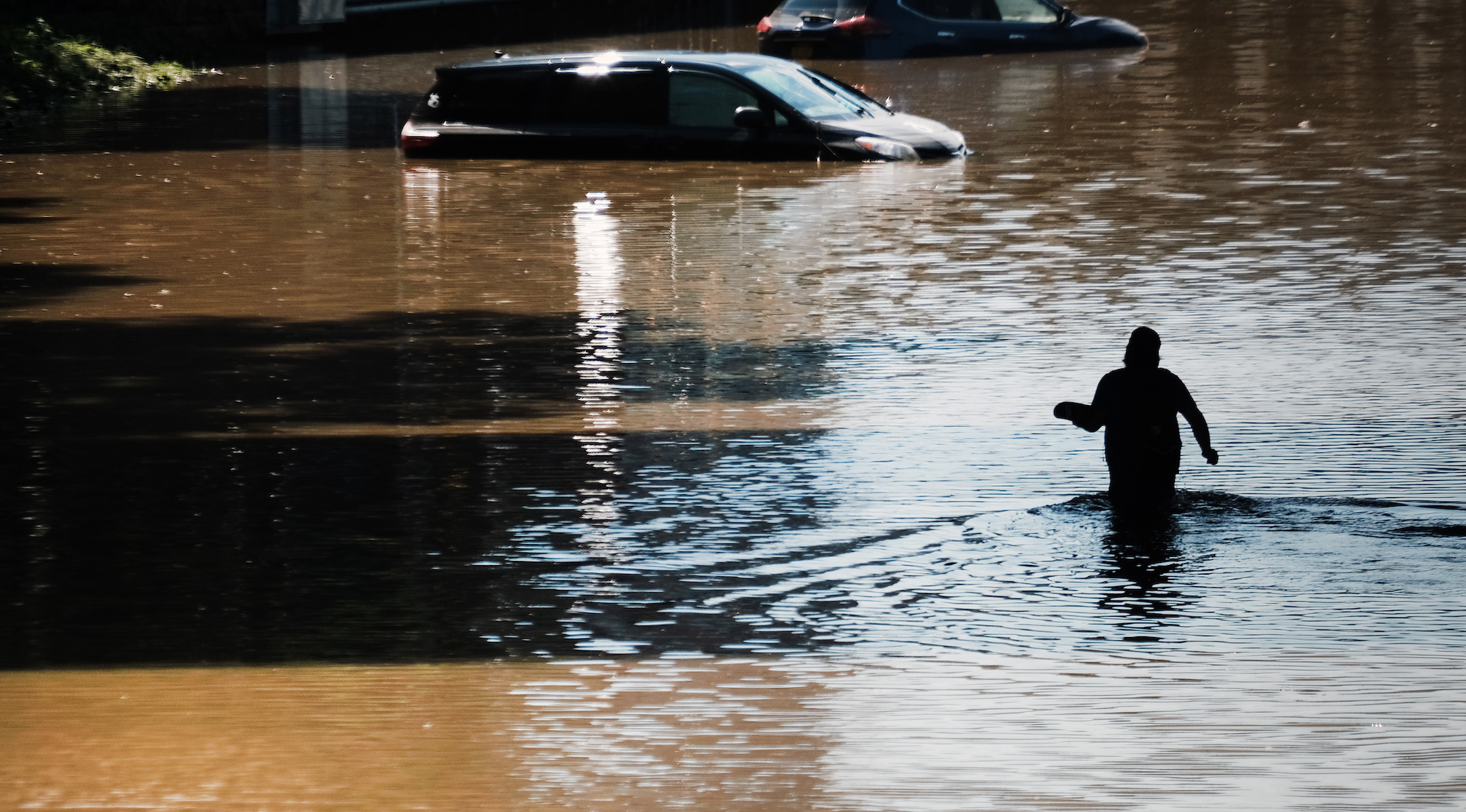 A man wades through the flooded Major Deegan Expressway in the Bronx, N.Y., following a night of heavy wind and rain from the remnants of Hurricane Ida, Sept. 2, 2021. (Photo/JTA-Spencer Platt-Getty Images)