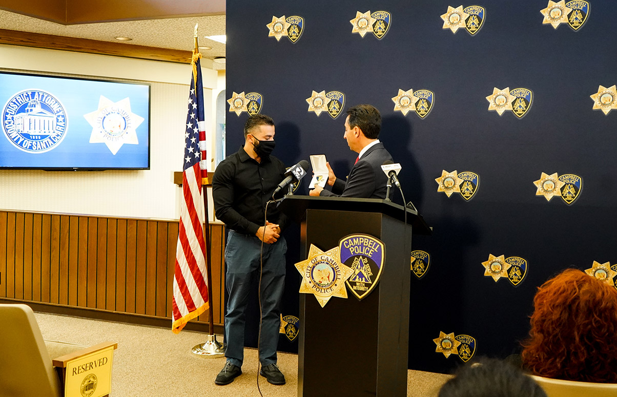 Farukh Mamedov (left) receives a Medal of Service from Santa Clara County District Attorney Jeff Rosen on Sept. 15, 2021. (Photo/Courtesy Santa Clara County Office of the District Attorney)
