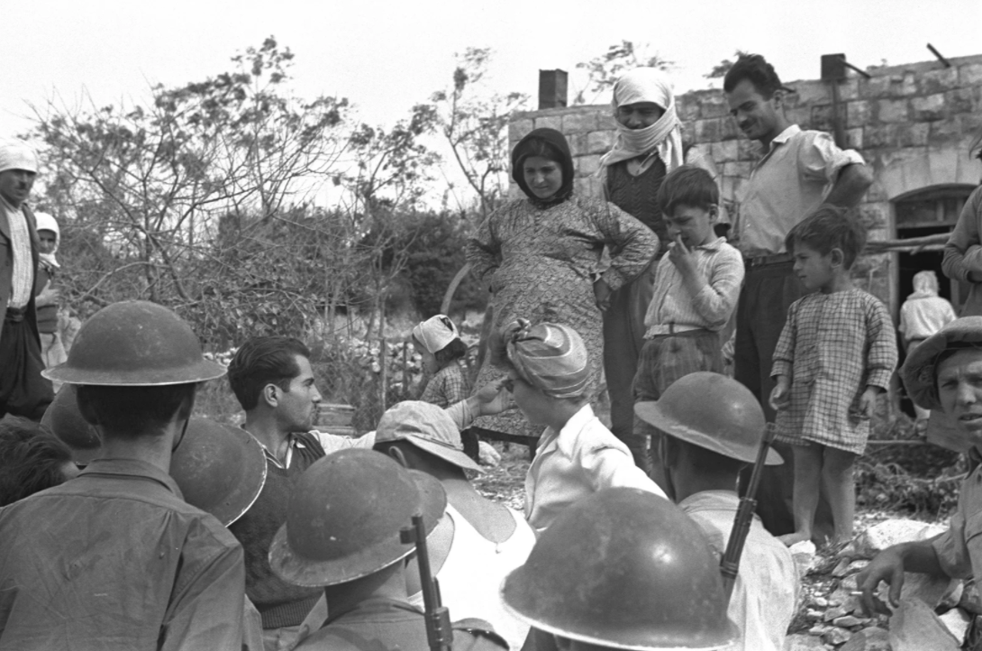Villagers and Israeli Defense Forces soldiers in Iqrit on Nov. 3, 1948. (Photo/RNS via the Israeli Government Press Office)