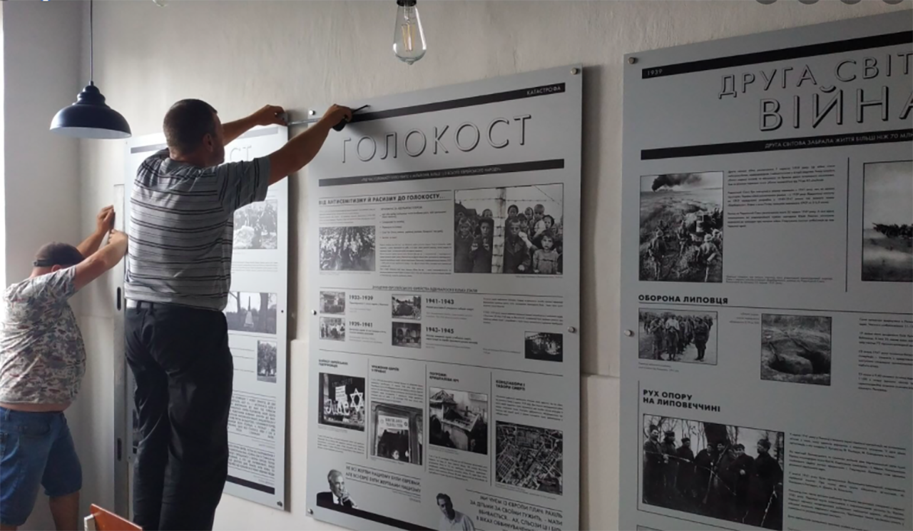 Volunteers put the finishing touches on the new Lypovets Holocaust museum.