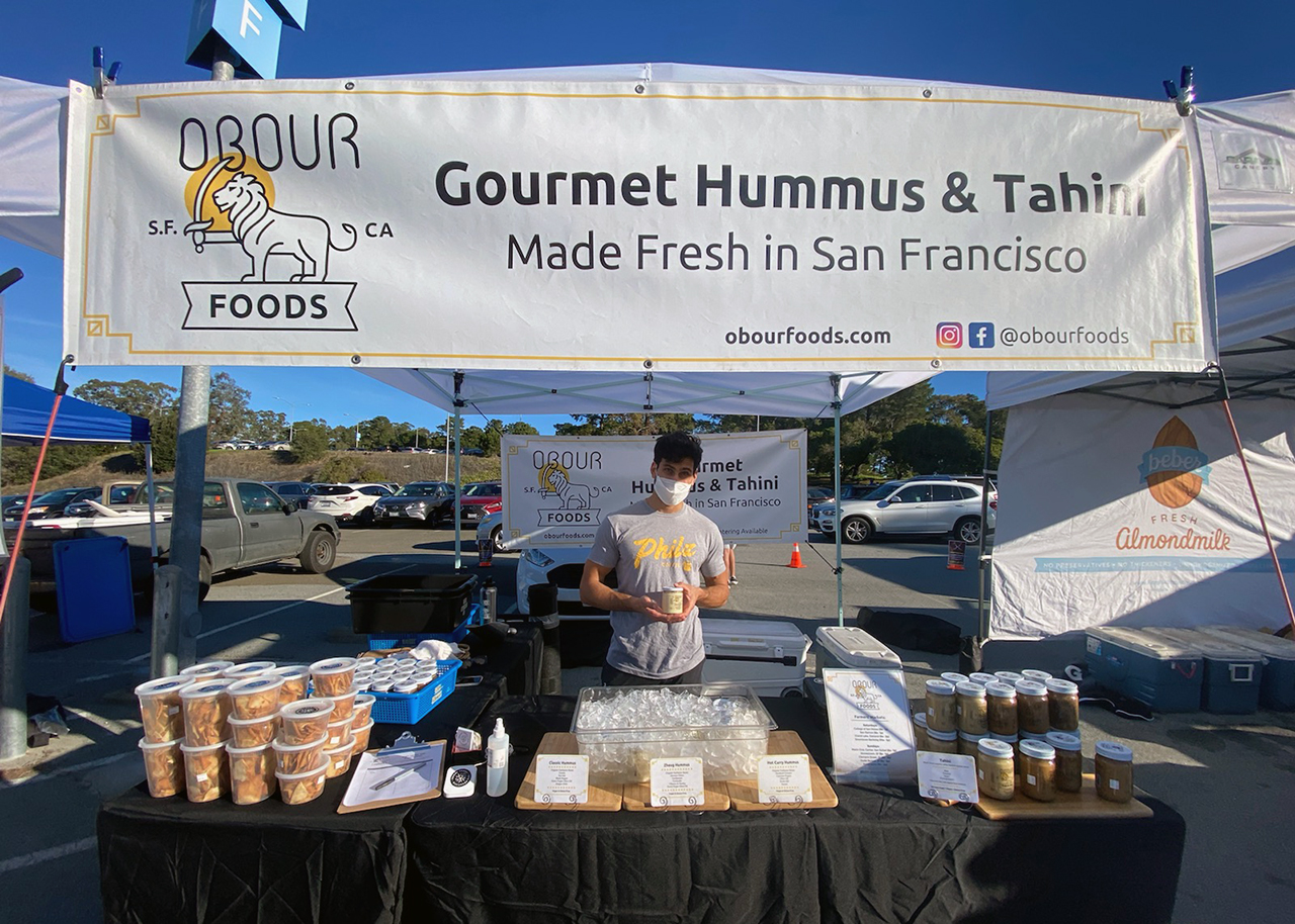 Elliot Sharifi of Obour Foods — coming soon to the Ferry Building — at a farmers market.