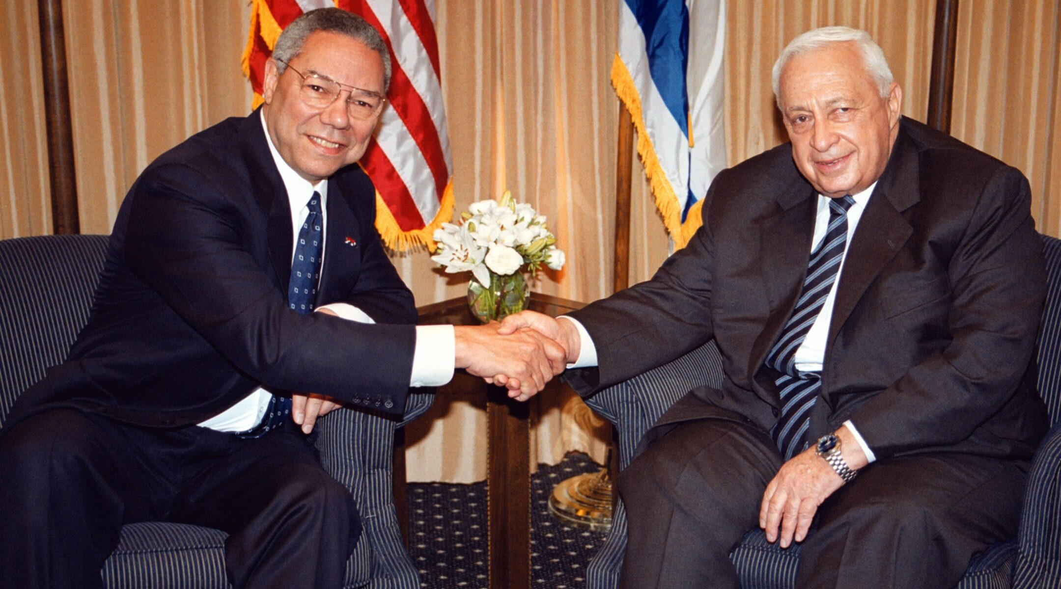 US Secretary of State Colin Powell (left) shakes hands with Israeli Prime Minister-elect Ariel Sharon in Jerusalem on February 25, 2001. (Photo/JTA-Getty Images-Pool photo)