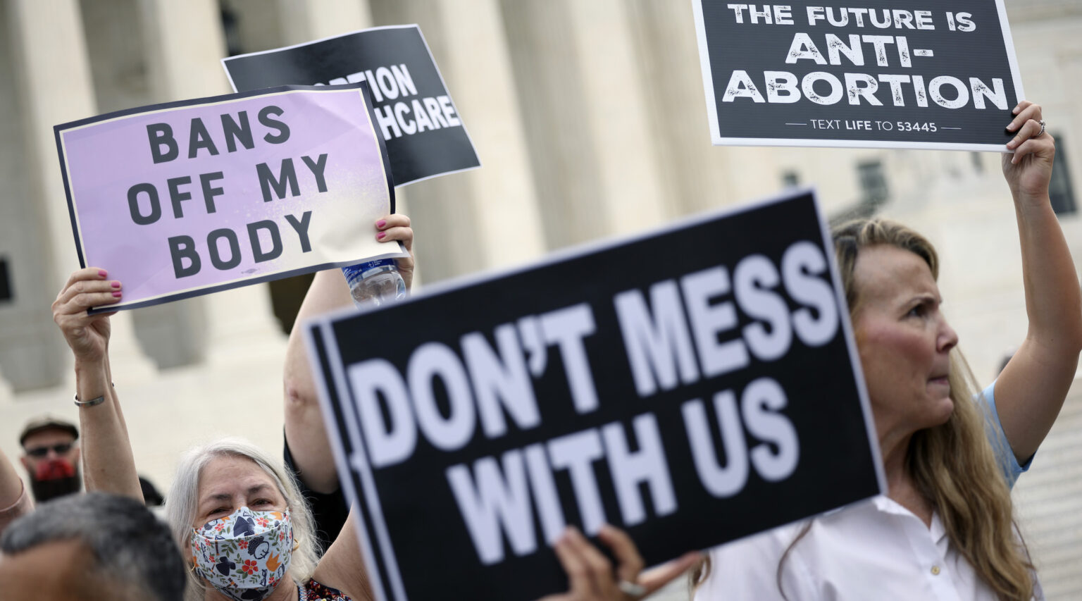 Pro-choice and anti-abortion activists protest alongside each other during a demonstration outside of the Supreme Court in Washington, D.C., Oct. 4, 2021. (Photo/JTA-Kevin Dietsch-Getty Images)