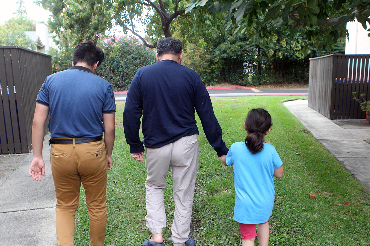 Mohammed with two of his five children in Concord, where the Afghan family has been resettled by JFCS East Bay. (Photo/Michael Fox)